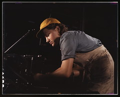 A lathe operator machining parts for transport planes at the Consolidated Aircraft Corporation plant, Fort Worth, Texas  (LOC)