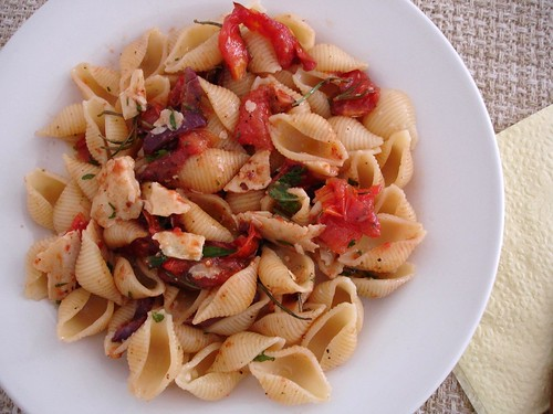 Pasta with tomatoes, olives, grana padano and basil