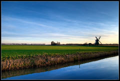 Sunset in Groningen (Wesley Danes) Tags: blue sky reflection green mill water netherlands field landscape weide searchthebest nederland groningen veld soe molen weiland landschap sloot kardinge reflectie wwpc aplusphoto diamondclassphotographer megashot