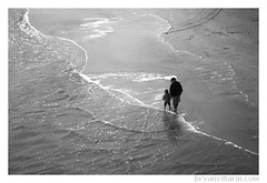 Walk with me (Bryan Villarin) Tags: ocean california people blackandwhite bw beach walking waves child mother pacificocean photowalk huntingtonbeach canoneosdigitalrebel photowalking canonefs1855mmf3556 photowalking021808