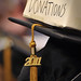 2011 College of Veterinary Medicine graduate solicits some financial aid during commencement.