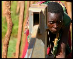 pumping water (LindsayStark) Tags: africa travel portrait war conflict uganda humanrights humanitarian displaced idpcamp refugeecamp idps idp humanitarianaid emergencyrelief idpcamps waraffected
