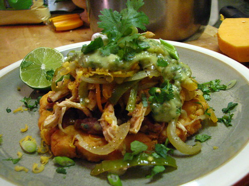 Shredded Chicken Sopes with Spicy Pinto Beans and Tomatillo-Avocado Sauce