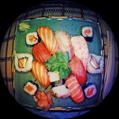sushi (Mas-Luka) Tags: italy food fish japan dinner sushi restaurant lomo lomography italia december rice salmon plate fisheye placemat slice meal chopsticks seafood nigiri modena tuna dicembre ristorante giappone japaneseculture ringflash 2007 riso giapponese pesce salmone butterfish preparedfish