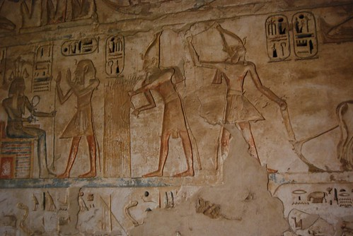 Ancient egyptian farmers plowing