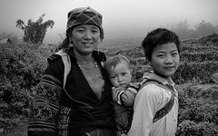 Mao's Family (Tinker & Rove) Tags: sapa himalayas hmong vietnam southeastasia travel adventure portrait family woman child infant boy farm rural ricepaddy terraced wildflower fog mist overcast blackandwhite embroidered scarf traditionalcostume smiling hoàng liên son