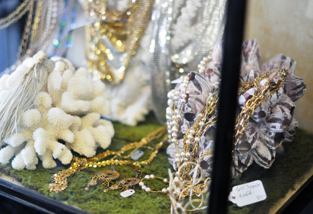 vintage necklaces on display with coral shells and barnacles