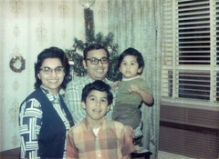 Tina, Ruben, James & Robert celebrate Christmas in Chicago. (12/1971)