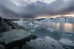 Glacial icebergs (ewahrlich) Tags: cloud ice water landscape grey iceland rocks gray glacier iceberg jokulsarlon jkulsrln sigma1020mmf456exdchsm canonrebelxti canon400d