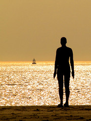 man and buoy .... (Chris Beesley) Tags: sea sun silhouette sand fuji finepix buoy crosby antonygormley anotherplace s5600 gapc buoyant mywinner abigfave superbmasterpiece photofaceoffwinner betterthangood