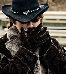 Harmonica (Doug NC) Tags: musician hat sunglasses strangers bodylanguage blow gloves kingspark cowboyhat harmonica frills mayitakeyourpicture peopleinpassing nikon18200vr kingsparkbluff