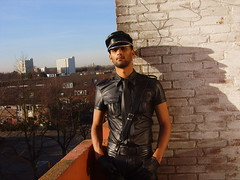 LeatherRomeo (mrle2009) Tags: sun amsterdam leather balcony cop