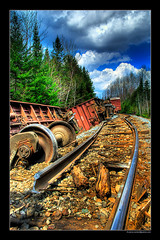 Broken Track (Pierre Contant) Tags: wood railroad sky cloud america forest train photoshop nikon quebec accident pierre rail railway bluesky locomotive canadianpacific boxcar cp cpr hdr derail cs3 ottawavalley temiscaming photomatix contant d80 railamerica ovr forestery multimegashot nikonflickraward pierrecontant nikonflickraward50mostinteresting