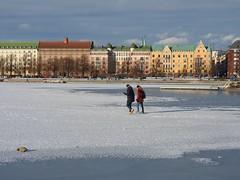 Sunday afternoon stroll on ice (KaarinaT) Tags: eira helsinki sea frozen ice finland twoguyswalkingonice houses colorfulhouses snow sunnyday sundayafternoonwalk colorful clouds sky city