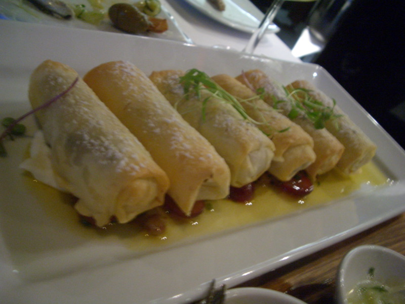 Lamb-filled lady finger filo pastries with labna and grapes