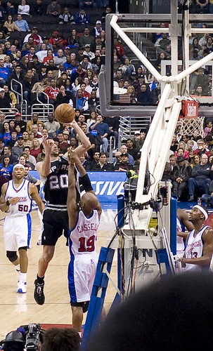 Manu over current Wizards coach Sam Cassell - flickr/eugene
