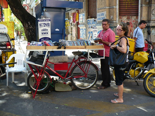 CD vendor on bike