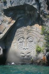 Maori Carvings, Lake Taupo (whistler1984) Tags: sculpture cliff lake art water face rock stone facade artwork mural kayak carving maori taupo hewnnewzealand