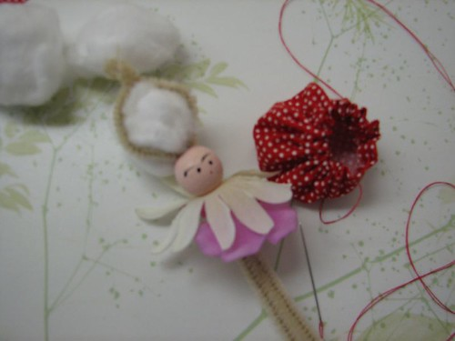put 2 chenille wires through head bead and twist top
