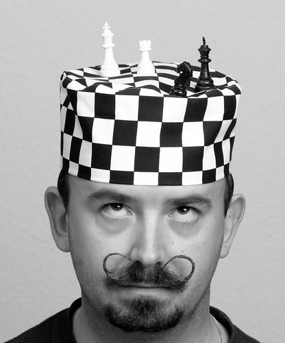 Game of Chess on Black and White Hat
