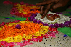 Lakshmi 'wicking' the lamp (parvation) Tags: flowers india lamp bright indian multicoloured oil pookolam