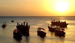 Zanzibar Sunset. (avp17) Tags: ocean africa travel sunset sun fish beach water d50 tanzania 50mm boat fishing nikon daressalaam indianocean unesco east zanzibar stonetown nikkor 18 50 trawler eastafrica nungwi