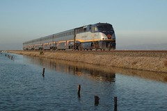 Eastbound Amtrak Capitol Corridor Pusher (sharkzan) Tags: favorite reflection sanjose trains amtrak frame wetlands sanfranciscobay alviso enlargement locomotives railroads capitolcorridor theone railfanning f59phi 3000views railpicturesnet cdtx2014 cooltrainpixblog