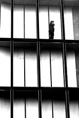 Behind the glass (pascalcolin1) Tags: paris13 bnf vitre glass window fenêtre homme man phone téléphone photoderue streetview urbanarte noiretblanc blackandwhite photopascalcolin