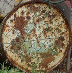 old 44 gallon drum (Foot Slogger) Tags: old texture fence rust industrial pattern rustycrusty almostsquaredcircle