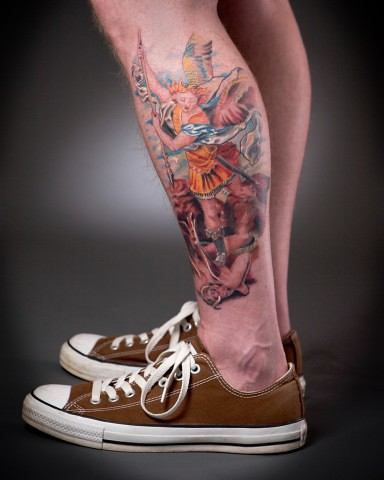 "This tattoo is a copy of the Raphael painting ""St. Michael Slaying the Devil"