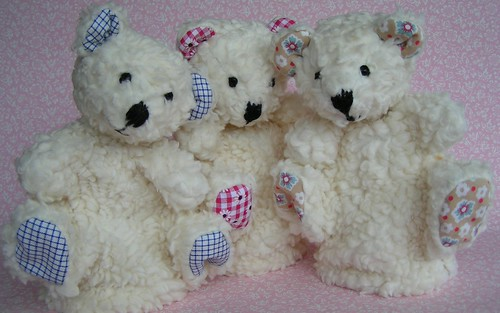 three hand puppet teddy's
