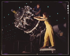 Women are trained to do precise and vital engine installation detail in Douglas Aircraft Company plants, Long Beach, Calif.  (LOC) (The Library of Congress) Tags: california woman usa man color yellow standing nice women october technology wasp stripes rosietheriveter aircraft wwii airplanes engine palmer slidefilm machinery worldwarii longbeach 1940s cables engines transparency overalls ww2 4x5 lf libraryofcongress 1942 douglas fertility largeformat striped mechanics longbeachca worldwar2 radial c47 wartime militaryaviation transparencies calfornia manufacturing prattwhitney womenatwork demography aeroengine   airplaneengines historicalphotographs douglasaircraft xmlns:dc=httppurlorgdcelements11 r1340 douglasaircraftcompany prattwhitneywasp october1942 dc:identifier=httphdllocgovlocpnpfsac1a35357 alfredtpalmer engineinstallation alfredpalmer airplaneindustry assemblylinemethods  radialaeroengine pistonaeroengine    captionable douglasaircraftcompanyplants