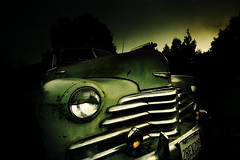 (parade in the sky) Tags: old longexposure color green car night vintage evening lowlight wheels perspective rusty surreal wideangle bumper vehicle 1020mm oldfashioned privateproperty avision