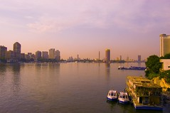 Peaceful Cairo. (Marwa Morgan) Tags: africa bridge blue sunset summer urban sun reflection cars water clouds river landscape boat nikon colours egypt vivid arabic nile cairo arab egyptian egitto egypte afrique d40 mywinners nikor1855 1855mmf3556gii goldstaraward beautifulsecrets gettyimagesmeandafrica1