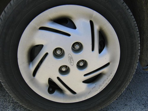 This is a photo of a steel wheel with a plastic wheel cover - also called a hub cap. If you look closely you can see the black steel wheel under the cover.