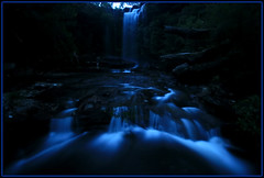 Falling Through Blue (down_the_rabbit_hole) Tags: blue nature water beautiful creek river evening waterfall bravo rocks stream dusk sydney dream royal parks surreal peaceful australia national nsw cottoncandy serene waterblur cascade tranquil lanscape waterscape meditative magicdonkey infinestyle goldenphotographer nationalfalls megashot bestofaustralia