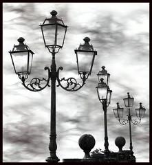 Arms towards the sky (Nespyxel) Tags: blackandwhite streetlamps pov lampioni stefano challengeyouwinner nespyxel stefanoscarselli pleasedontusethisimageonwebsitesblogsorothermediawithoutmyexplicitpermissionallrightsreserved
