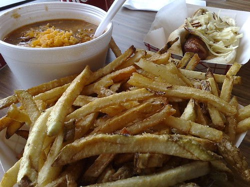 Clockwise from bottom: Duck Fat Fries, Buddy Hackett Bowl O' Sausage Chili, and Brandy-infused Spanish Chorizo