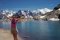 I think she likes it here... (Ron Layters) Tags: blue lake snow france mountains alps ice nature water hat geotagged interestingness slide explore transparency agfa chamonix montblanc lacblanc aiguillesrouge hautesavoie ctprecisa agfachrome flickrfly ronlayters ronet slidefilmthenscanned massifdumontblanc chamonixaiguilles oldrefuge geo:lat=459817 geo:lon=68913 highestposition231onwednesdaydecember122007