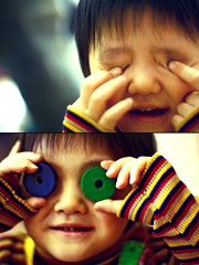 no eyes. (cathycracks) Tags: boy cute smile japan toy happy kid student eyes diptych colorful hokkaido dof child play stripes fingers young poke   ren kindergarten kindergarden diptychs takikawa canonef50mmf14  youchien  goodfishiescom  takikawayouchien takikawakindergarten