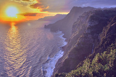 Madeira: Santana Sunrise (Mr.Enjoy) Tags: ocean morning blue light sea wild orange cliff costa sun seascape green beach portugal nature sunrise point landscape waterfall scenery europe natural north lookout enjoy coastline belvedere santana madeira ilha hdr sights norte northcoast ilhadamadeira themoulinrouge madeiraisland madre rochadonavio pshdr pscla platinumphoto anawesomeshot superbmasterpiece quintadofuro llovemypic