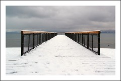 The Pier (on2wheelz) Tags: california morning winter snow cold dark pier december tahoe laketahoe olympus brooding stark almostblackandwhite soe truckee kingsbeach 1454mm supershot 10faves mywinners theexhibit impressedbeauty jeffav platinumheartaward jeffav2007 laketahoesunrise