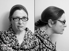 doris was always a little strange (tamelyn) Tags: selfportrait me self glasses mugshot busted doris hairnet housedress longbottom crazycatwoman thelunchlady utata:project=mugshot