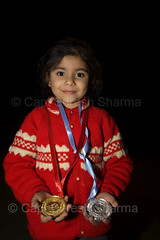 Our Daughter Sukhmani Won Gold and Silver Medals (Captain Suresh Sharma) Tags: red baby india game sports girl smile proud happy sweater asia child display skating daughter decoration young happiness achievement winner prize punjab ethnic reward showing chandigarh punjabi woollen medals honour panjabi haryana panchkula happychild sukhmani sikhbaby captsureshsharma prideoffamily exhibitingrewards