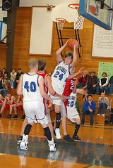Baxter Davies pulls down a rebound in Crane�s win over Spray. (Photo by DEBBIE�RANEY)