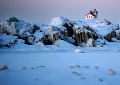 The Lorain lighthouse peeks out from behind the frozen Lakeview Park breakwall (ronnie44052) Tags: winter ohio lighthouse lake snow ice lakeerie greatlakes lorain lighthousetrek