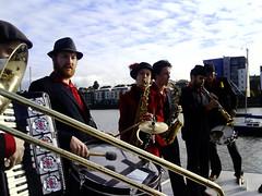 Brass aboard the Trinity Bell (kat's_eye) Tags: scotland ship crane champagne si trombone launch brass cammy ondeck granton september2007 orkestradelsol grantonharbour simonowen ridiculouslysmallphotosfromacameraphone trinitybell