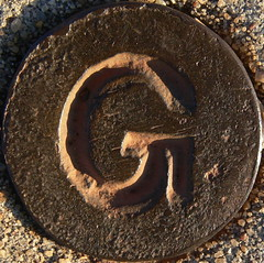what does G stand for? (Foot Slogger) Tags: shadow sign symbol footpath almostsquaredcircle