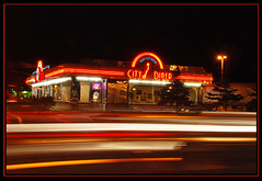 Anchorage Impressions '07 - Diner 1 (heritagefutures) Tags: nightphotography copyright trafficlights cars alaska night neon traffic diner retro anchorage hr benson dirk allrightsreserved citydiner lightstream spenard spennemann ysplix heritagefutures dirkhrspennemann heritagefuturesallrightsreserved copyrightdirkhrspennemann ausphoto