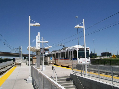 Denver RTD light rail train at the Nine Mile Station on the southeast